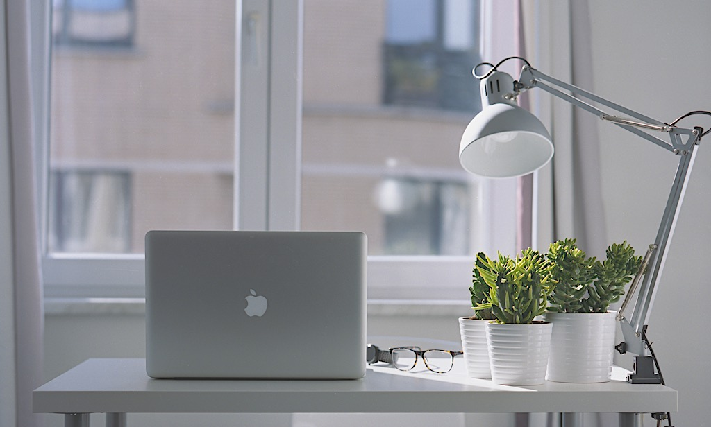 Laptop with the lamp on the desk in the day light